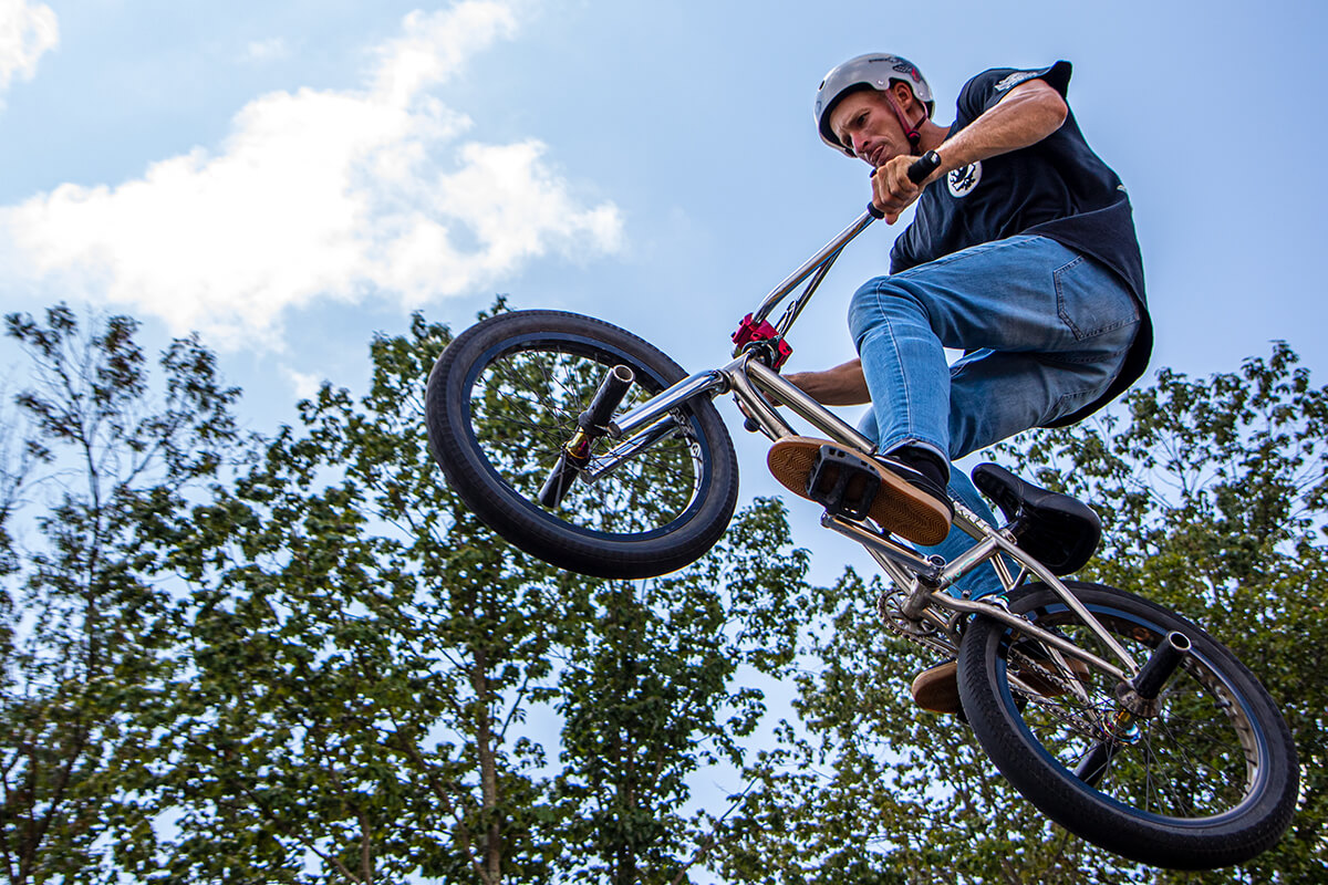 Man in the air on BMX bike during the stunt show at Diggerland USA