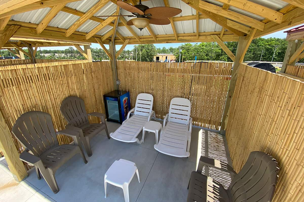 Bird's eye view of cabana rental with chairs, tables and cooler.