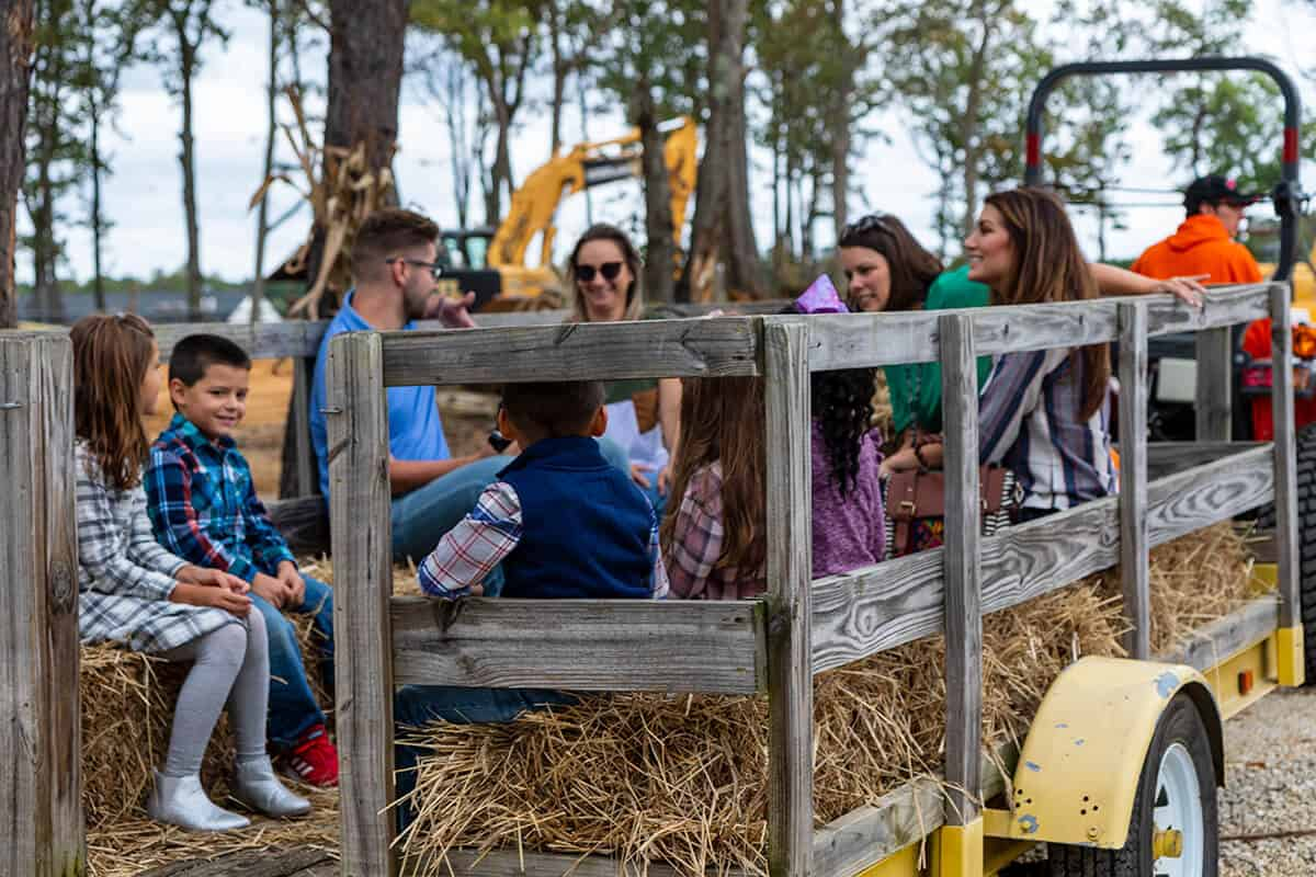Kids and adults smiling on a hayride